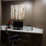 Business center for guests with printer and office supply