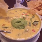 Queso Completo with Chile con queso with ground beef, guacamole and pico de gallo.