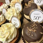 Assorted 50th Birthday Cupcakes with Party Picks by Flavor Cupcakery