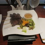 Our steak sa-te appetizer hit the spot. Note the 2-burner hot plate to keep plate warm.