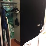 Limited space for hanging clothes items and door opens right in front of sink/closet area.