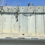 People scale the wall to work in the Israeli territory every day.