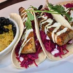 Panko crusted fish tacos with pickled slaw and side of rice/beans. My fish was dry.  #UpCloseSav