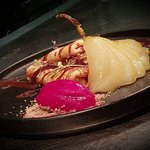 French crepes with vanilla poaced pear, raspberry sorbet and milk chocolate sauce