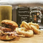Pork belly slider with apple slaw and onion rings