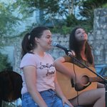 Singer and guitarist performing outside Mademoiselles