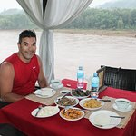 Dinner overlooking the river - high rainfall