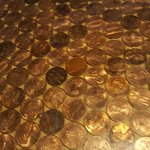 Pennies on the bar top under resin
