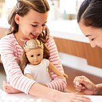 Girls - and dolls - can enjoy mini-manicures the American Girl Salon