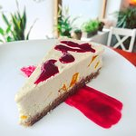Luxurious & creamy vegan mango & raspberry cheezecake