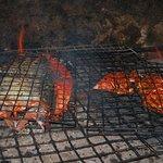 cocinando el famoso Tikin Xic Dish Fish