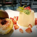 House made yoghurt pannacotta with caramelised figs and fresh strawberries.