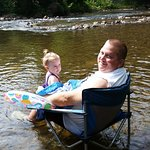 Playing with granddaughter in Cullasja River next to campsite