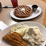 fried catfish, grits, eggs and a waffle. I had red Kool-Aid too