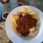 Beef madras curry with rice, chips, naan and mango chutney.