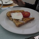 A modest single poached egg with tomato