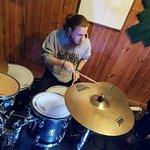 Louis playing at a jam