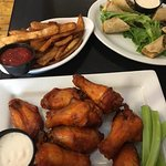 Fries $3, wings $8, Philly spring rolls $9