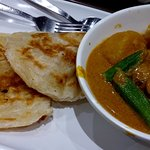 Singapore chicken curry with Indian pancake