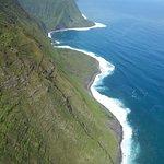 Flying over Maui cliffs
