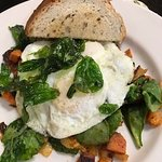 Sweet potato hash with spinach, eggs, and rye toast