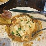 Shrimp and grits, cornbread on side