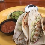 Grilled fish (mahi) tacos, with guacamole and roasted tomato salsa