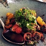 Heirloom tomato and burrata salad with olive caper vinaigrette