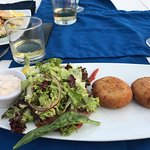 My fish cakes were delicious I loved the salad.