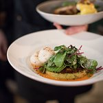 SWEET CORN FRITTER & AVOCADO smashed greens, poached eggs, smoked tomato