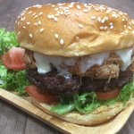 Simples special burger,  6oz Pattie topped with BBQ pulled pork and cheddar cheese.