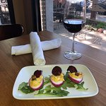 deviled eggs with crispy pork belly and beet chip