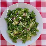 Summer love salad is made of  Lettuce,melon cubes,greek crushed feta cheese,raisins&ceasars dres
