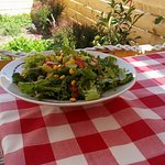 Our Love salad is made of lettuce,sun dried tomato,fresh tomatoes cucumber cubes and corn crops.