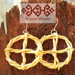 Solarcross-earrings made of roots.