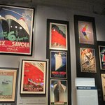 A wall display of the iconic travel posters for the liner companies