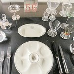 A place setting with Lalique glassware