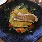 Red fish fillet on ratatouille-filled ravioli
