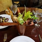 Celebration Bloody Mary: a bloody mary with andouille sausage, shrimp, steak, ham, potatoes, oli