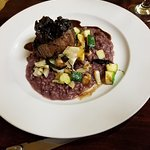 Grilled Tenderloin on black truffle risotto, w/vegetables, Cipollini onions, red wine butter sau
