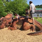Climbing a dinosaur at the Living Museum.
