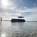 Beautiful day at Shell Island with a Salty Pontoons boat.