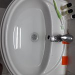 No place to keep things in bathrooms. Water clogging in wash basins.
