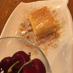 Homemade Aladino cake and fresh cherries