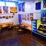 Our deli area with spacious tables and rotating local art displays