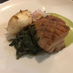 Roasted pork belly with turnips, turnip greens and ramp kraut