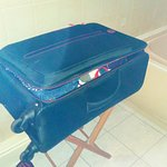 suitcase stand is in bathroom, no room in bedroom room 17