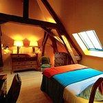 La chambre ALFRED, le charme d'une charpente et d'un parquet en chêne