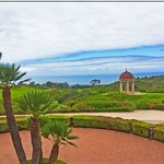 Golf course and chapel above the ocean.