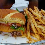 A photo of one half of their bison burger and fries